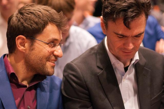 Levon Aronian, always smiling, having a whisper to Dutch Grandmaster, Loek van Wely.