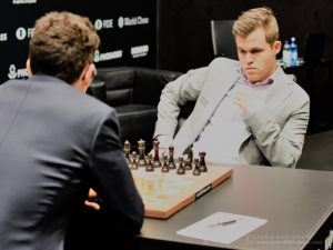 Magnus Carlsen faces Fabiano Caruana over the board at the start of round 5 of the FIDE World Chess Championship. Photograph by John Lee Shaw © www.hotoffthechess.com.