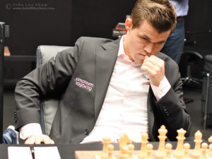 Magnus Carlsen at the start of round 7 of the FIDE World Chess Championship 2018. Photograph by John Lee Shaw © www.hotoffthechess.com.